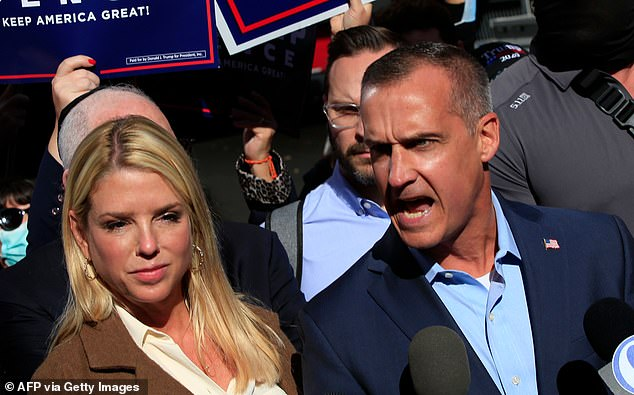 Trump campaign adviser Corey Lewandowski, with former Florida Attorney General Pam Bondi (L), speaks outside the Pennsylvania Convention Center in Philadelphia. Trump's campaign attacked the state's mail-in voting system and leveled allegations of fraud