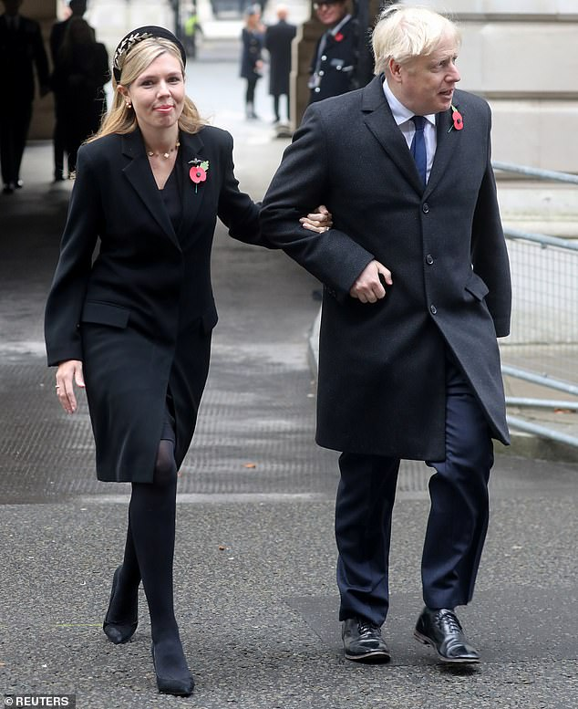 Boris Johnson had initially offered to promote communications Lee Cain to become chief of staff. But he dropped the plan following objections from his partner Carrie Symonds (pictured with Mr Johnson last week)