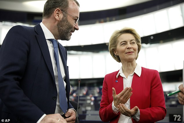 Senior German MEP Manfred Weber (left, with European Commission President Ursula von der Leyen), who is an ally of Angela Merkel, claimed yesterday's announcement was a sign of the UK government losing direction