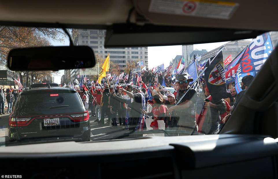 At around 10.30am, Trump departed the White House and his motorcade drove past the gathering crowd of cheering supporters who had arrived for the Million MAGA March