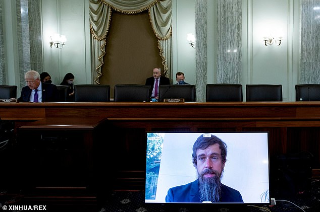 During a Senate committee hearing October 28, Twitter CEO Jack Dorsey (pictured on the video screen) defended the company's practice of labeling disputed claims about U.S. elections while leaving alone 'saber rattling' tweets from world leaders, such as a tweet from Khamenei that referred to Israel's 'Zionist regime' as a 'deadly cancerous growth'