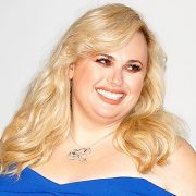 Rebel Wilson Rocks Plunging Green Swimsuit After 50 Lb. Weight Loss & BF Jacob Busch Says It's 'Fire'