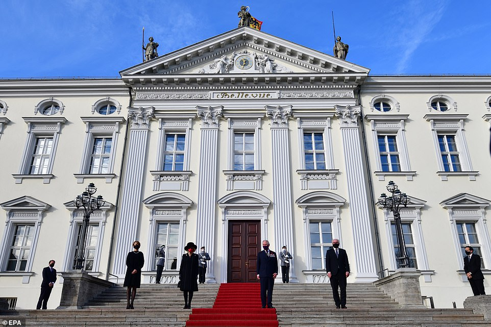 German President Frank-Walter Steinmeier and First Lady Elke Buedenbender pose on the steps of Bellevue palace with Prince Charles and the Duchess of Cornwallon Germany's National Day of Mourning that commemorates victims of war and fascism