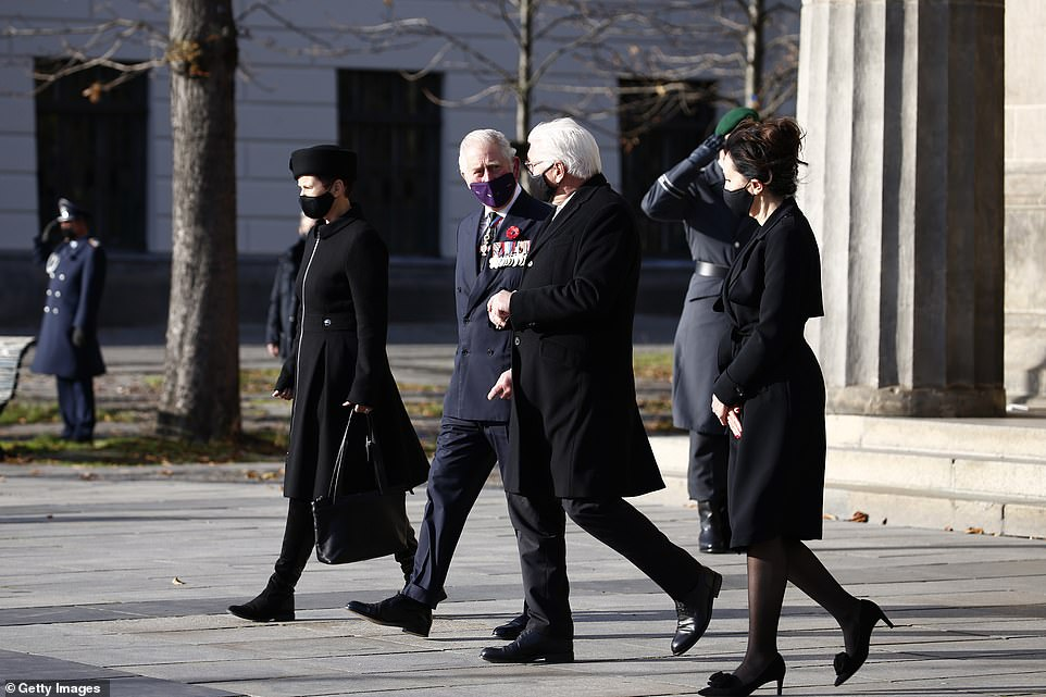 Prince Charles and German federal State President Frank-Walter Steinmeier leave after they laid a wreath at the Neue Wache memorial to victims of war and tyranny