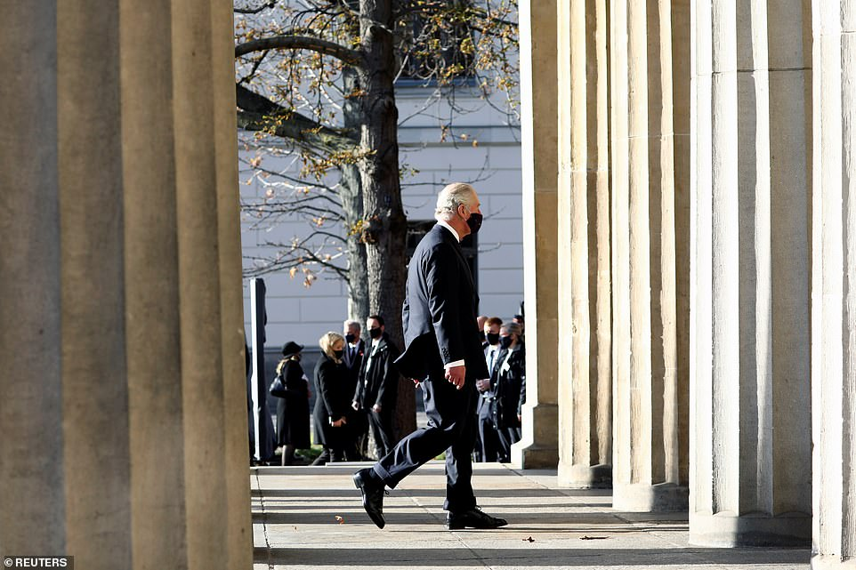 The Prince of Wales is pictures arriving for the annual wreath laying ceremony, making his way to the Neue Wache memorial to mark Remembrance Day in Berlin
