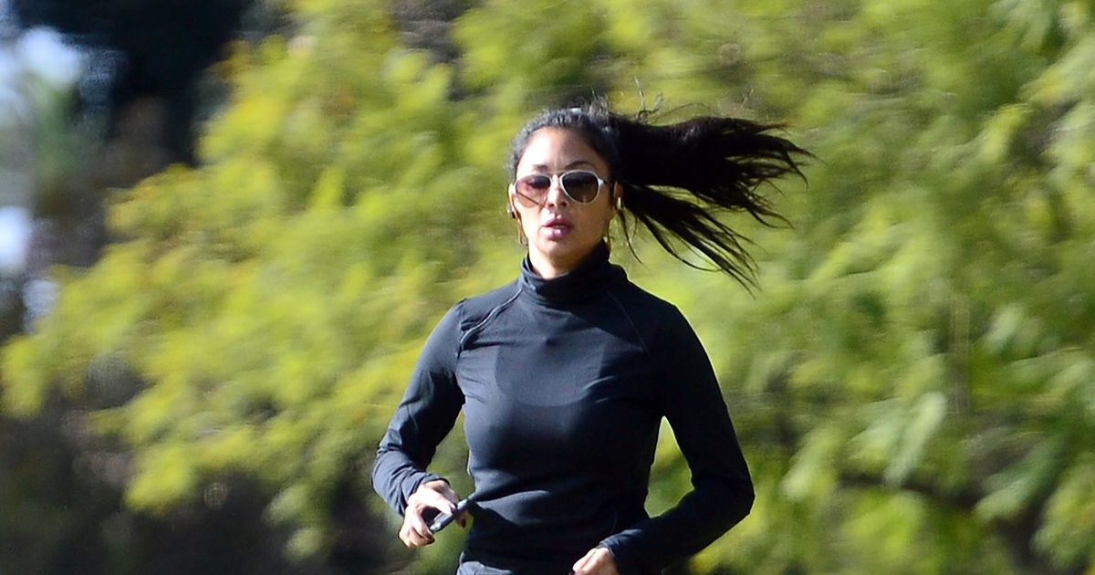 Nicole Scherzinger displays her impressive flexibility skills during workout