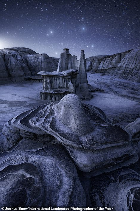On the left is a shot called Interstellar by American photographer Joshua Snow, who was named International Landscape Photographer of the Year runner-up. His stunning image was taken in the arid desert of the New Mexico Badlands