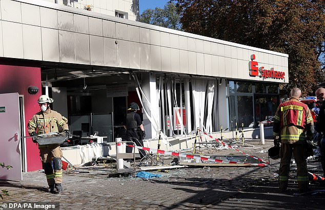 2014: Emergency workers at the scene of a Berlin bank which was blown up during an £8million robbery