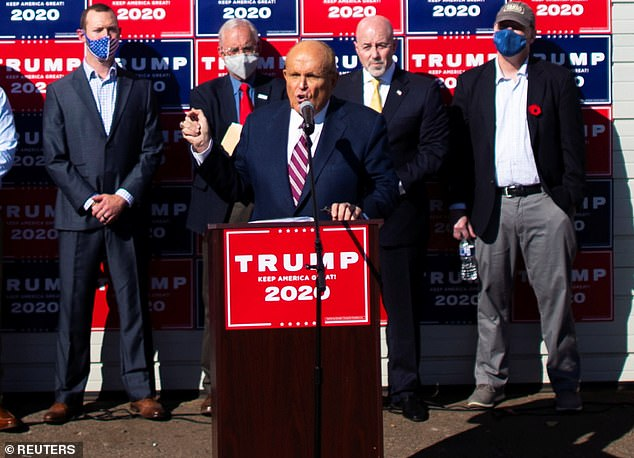 Legal chief: Rudy Giuliani - seen at the infamous Four Seasons Total Landscaping press conference on the day the election was called for Trump - had to appear in court for the president as he runs out of lawyers