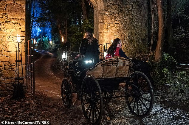 Arrivals:Russell and Ruthie arrived on a horse and cart and were given jester's costumers to entertain the celebrities who had arrived to watch the trial