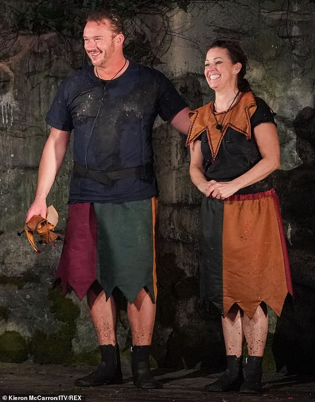 Well done:Ruthie and Russell had to wear clear large trousers over their outfit which would be filled with crickets and cockroaches. Wearing head-phones they had to dance to iconic songs and their fellow campmates had to guess what the song was
