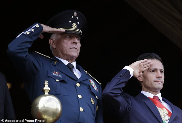 Cienfuegos is seen left alongside Mexico's then-President Enrique Pena Nieto during the annual Independence Day military parade in Mexico City's main square in November 2020