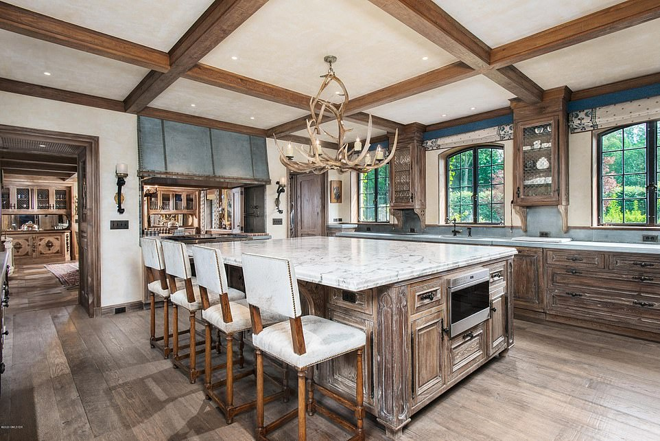 Low key:The large kitchen features granite countertops and convenient island seating for more casual meals and snacks