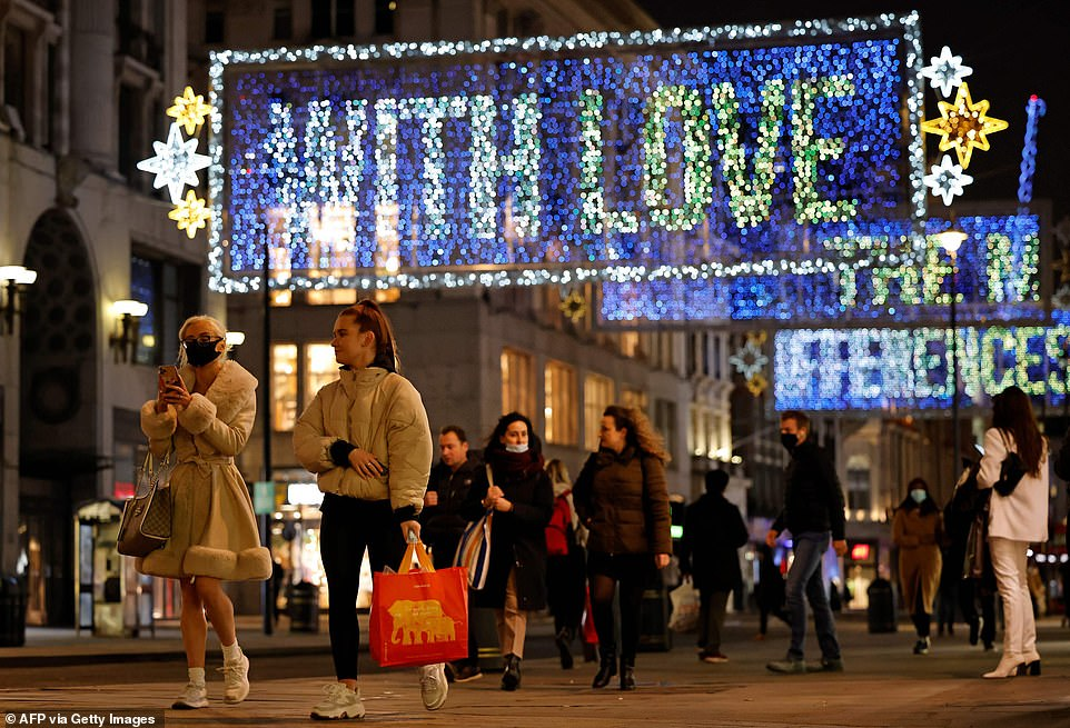Ministers are examining a series of options to relax restrictions around Christmas. Pictured: Oxford Street in London