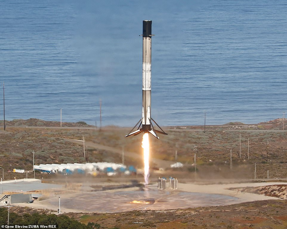 The dramatic image above shows the first stage booster returning to a bullseye landing at Vandenberg Air Force Base in California on Saturday