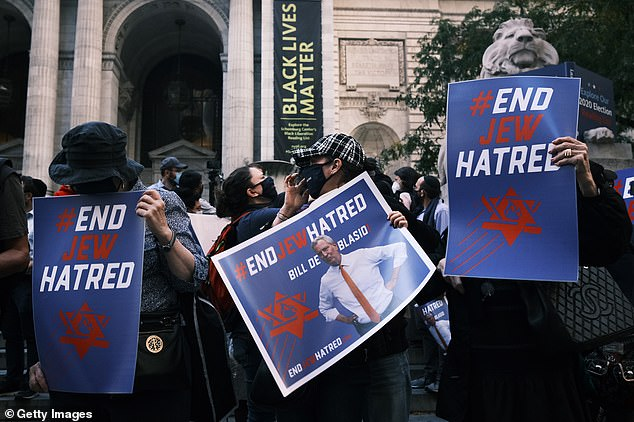 Pictured:Protesters rally in Manhattan against the closing of some schools and businesses in Jewish neighborhoods in the Brooklyn and Queens boroughs due to a spike in the numbers of Covid-19 cases in these neighborhoods, October 15