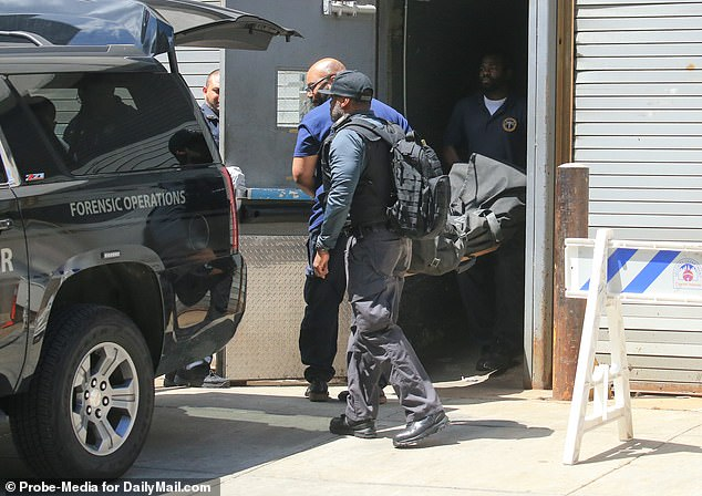 The body of Jeffrey Epstein is brought out by medical examiners at hospital in New York. Disgraced financier Epstein, 66, was found dead in his cell in August last year while awaiting trial at New York City's Metropolitan Correctional Center