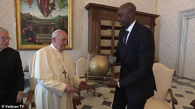 Pope Francis receives a golden basketball from Memphis Grizzlies forward Andrew Tolliver
