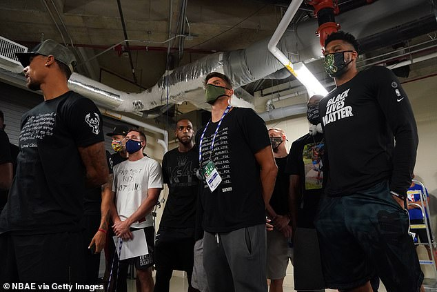 Kyle Korver (center) and Giannis Antetokounmpo of the Bucks are pictured after the team boycotted a game in response to the Kenosha, Wisconsin police shooting of Jacob Blake