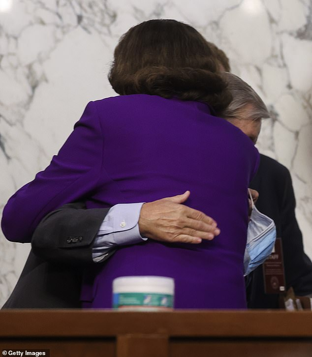 Chairman Senator Lindsey Graham (R-SC) and Ranking Member Sen. Dianne Feinstein (D-CA) embrace following the fourth day of confirmation hearings for Supreme Court nominee Judge Amy Coney Barrett on Capitol Hill in Washington