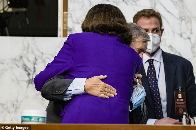 Republicans rushed to confirm Barrett before election, shifting the court to the right for decades. Democrats felt Feinstein, pictured hugging Graham did not fight hard enough for the seat