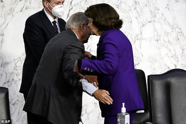 Feinstein's stepping down comes after she drew the ire from progressives for her handling of Amy Coney Barrett's contentious Supreme Court confirmation including this hug with Graham