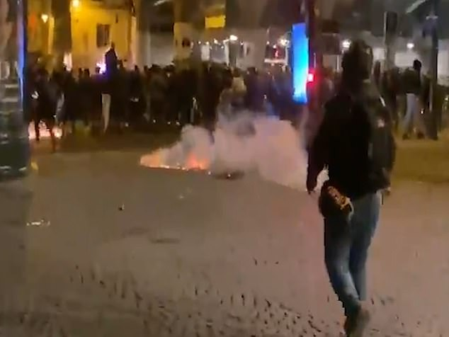 Tear gas was used in an attempt to disperse the crowd of hundreds from central Paris