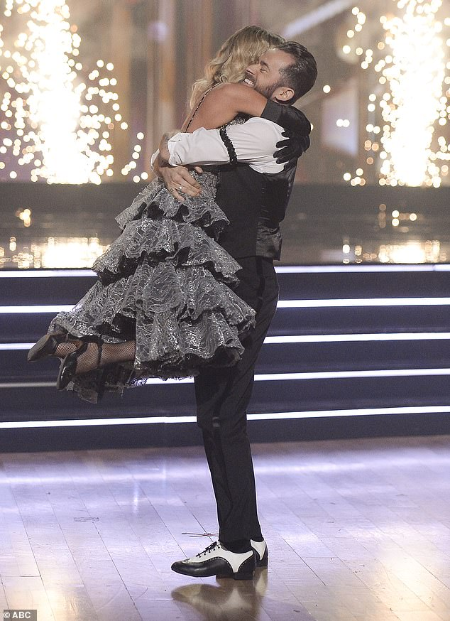 Big hug:Kaitlyn, 35, reeled in disbelief, and Artem, 38, collapsed to the floor, then they rose and hugged each other, swinging around and around