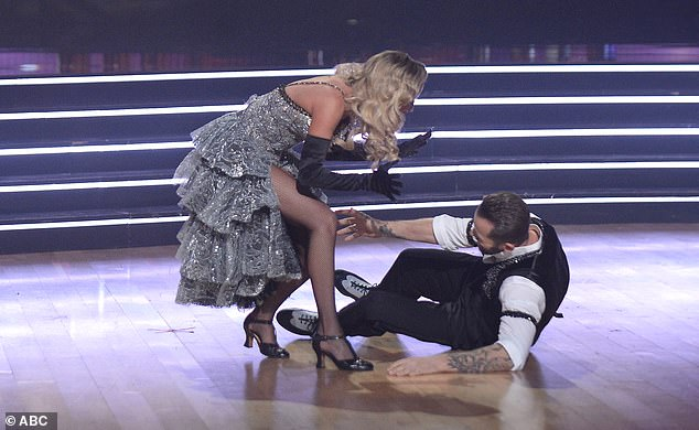 Dancer down: Artem fell to the floor in disbelief when they were named the winners
