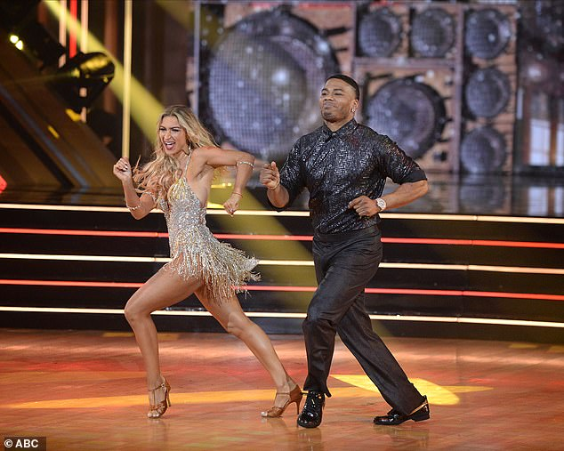 Samba routine:Nelly and Daniella Karagach, 28, revisited the joyful samba they did in Week 5 to DeBarge's The Rhythm Of The Night, which scored them 27 points