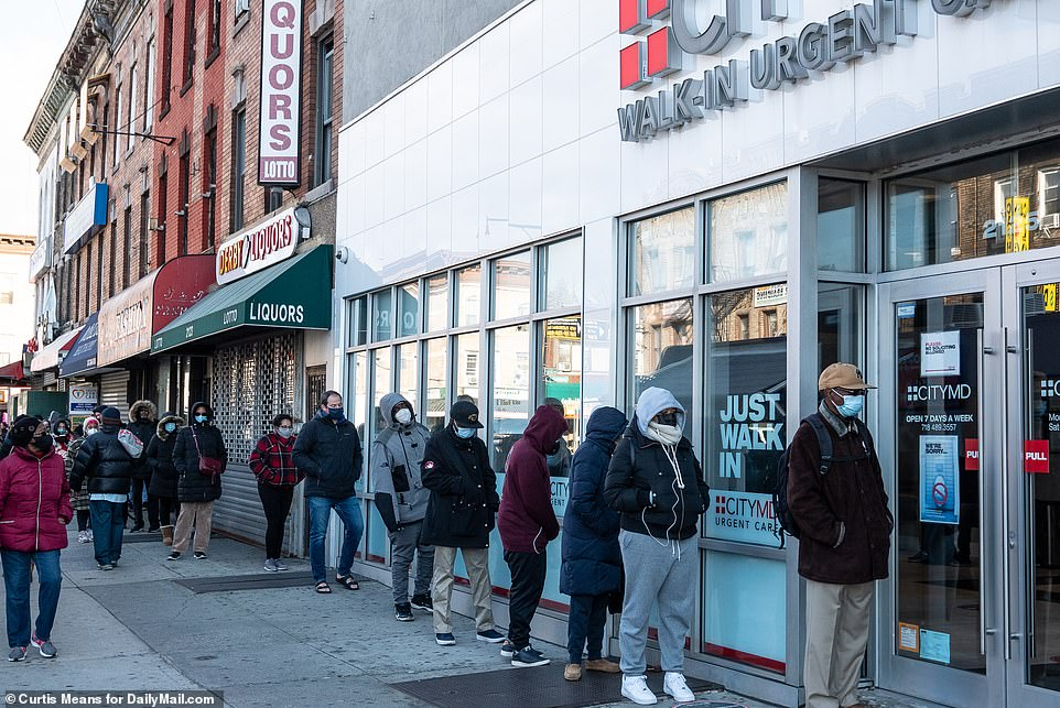 BROOKLYN, NYC: Dozens of people line up outside a CityMD on Nostrand Avenue in Flatbush, Brooklyn, as coronavirus cases continue to surge across New York