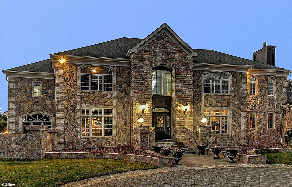 Big place: The5,420-square-foot homehas four bedrooms, five baths, a gym, and a heated pool