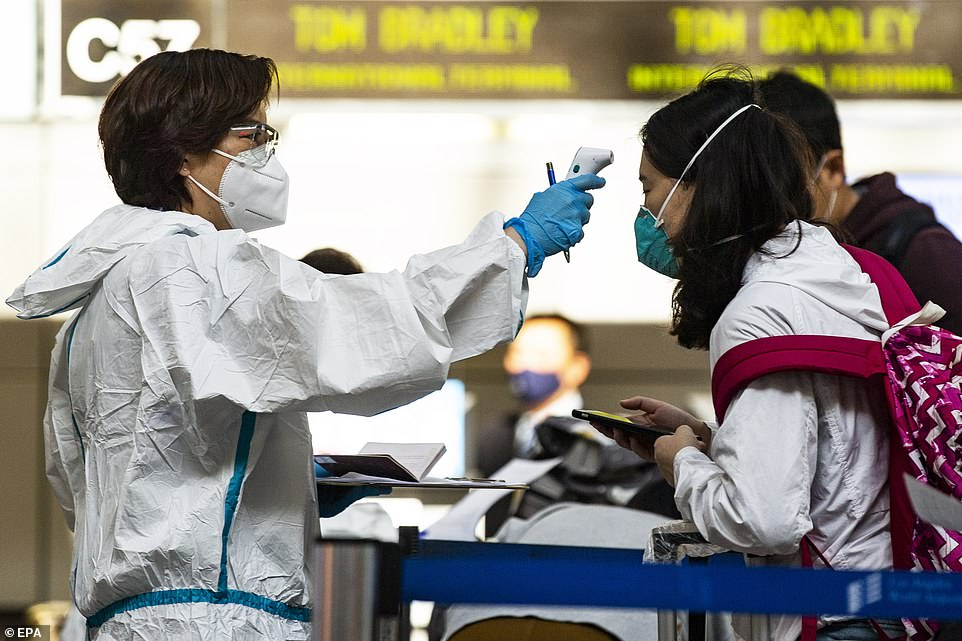 LOS ANGELES: Travelers are screened and have their temperature checked by airline employees at LAX on Tuesday