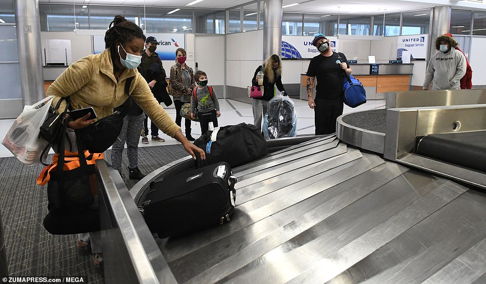 MILWAUKEE: Passengers collect baggage at General Mitchell International Airport two days before Thanksgiving