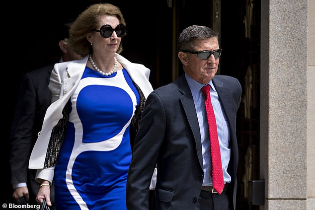 Michael Flynn, former U.S. national security adviser, and lawyer Sidney Powell, left, exit federal court in Washington, D.C., U.S., on Monday, June 24, 2019