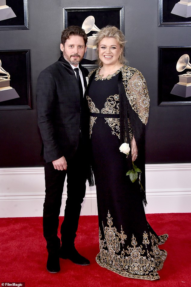 She gets the kids: Kelly Clarkson has been awarded primary physical custody of her two children kids, it was revealed in court documents on Monday (pictured 2018)