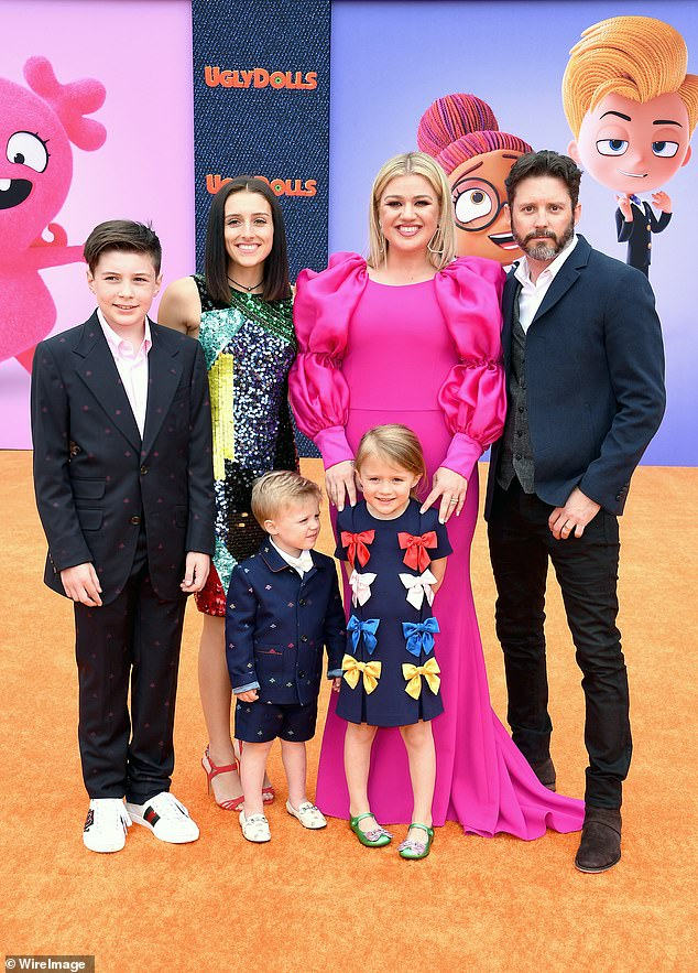 Hard on her: Clarkson said she was not going to be fully transparent about the split on account of her children. From left, Seth Blackstock, Remington Alexander Blackstock, Savannah Blackstock, Kelly, River Rose Blackstock, and Brandon in April 2019