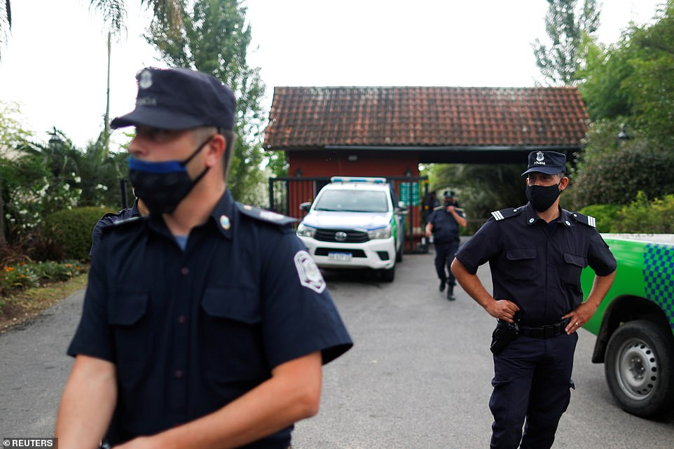 Police officers outside Maradona's home on outskirts of Buenos Aires, Argentina, on Wednesday