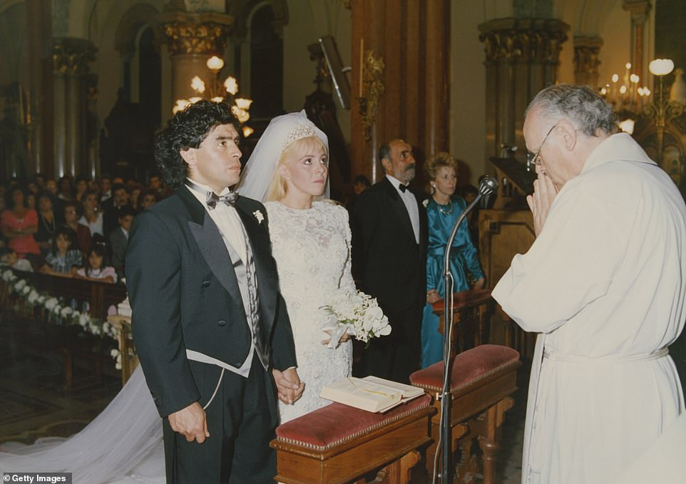 Diego Maradona and Claudia Villafane stand in front of the altar during their wedding ceremony at Santisimo Sacramento Church in 1989