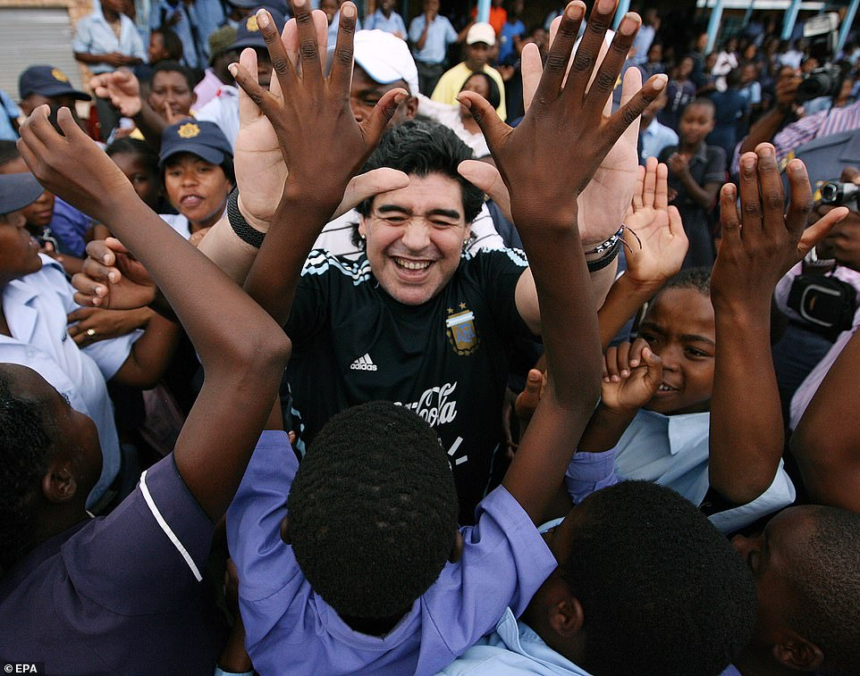 Argentinian national soccer team head coach Diego Maradona (C) greets schoolchildren during a visit to Kgotlelelang Primary School in Winterveldt, north of Pretoria, South Africa, 19 January 2010