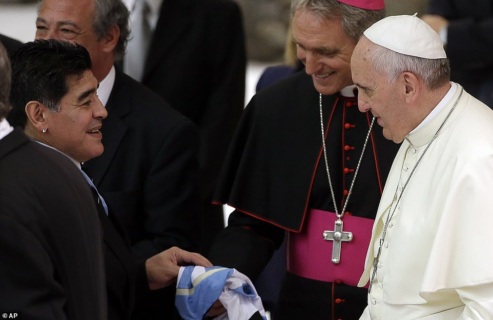 Maradona, left, greets Pope Francis in the Paul VI hall at the Vatican, ahead of an inter-religious match for peace in September 2014
