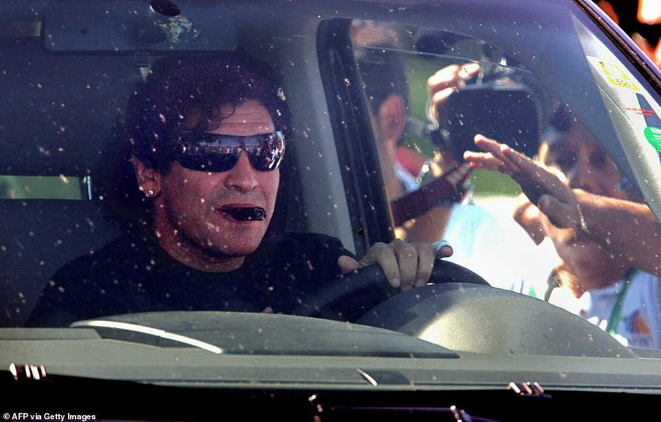People wave to Argentinean football star Diego Maradona as he drives out of a hotel in southern Germany during the World Cup there in 2006