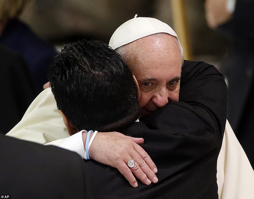 Maradona hugs Pope Francis in the Paul VI hall at the Vatican in 2014