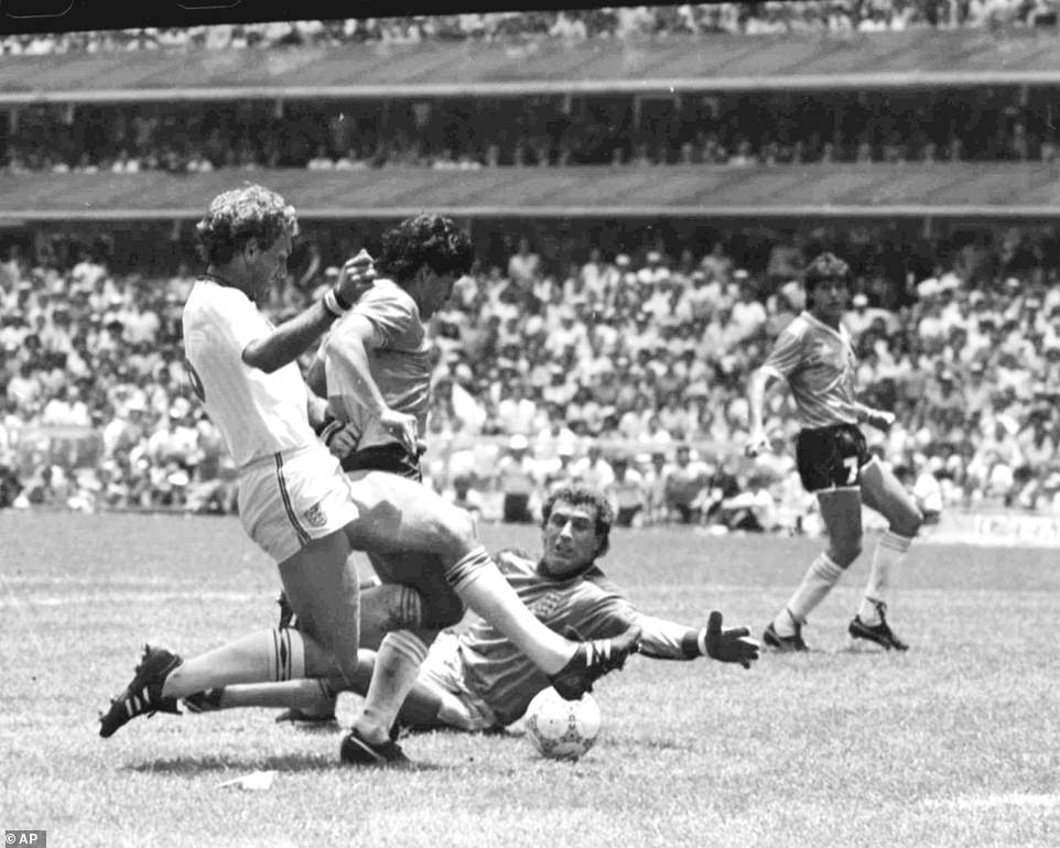 Maradona, second left, scores his second goal against England during the World Cup quarter final match, in Mexico City, Mexico, on June 22, 1986