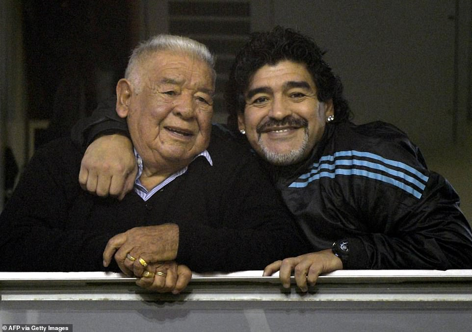 Maradona (right) embraces his father 'Don Diego' before the start of the Copa Libertadores 2012 first leg semifinal football match between Argentina's Boca Juniors and Universidad de Chile at 'La Bombonera' stadium in Buenos Aires, Argentina