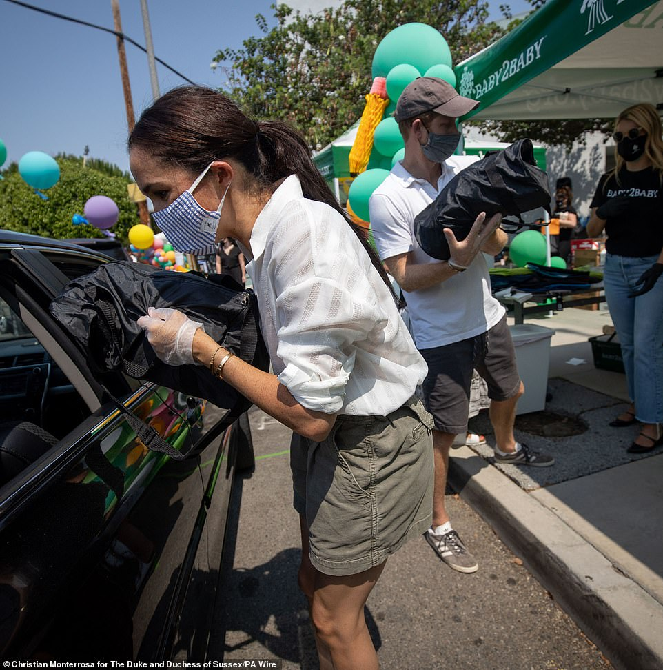 In August Harry and Meghan handed out school supplies, clothing and nappies to families in need at a drive-thru event in Los Angeles organised by charity baby2baby. Today it emerged this event was just weeks after her miscarriage