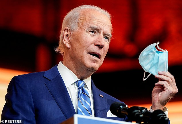 President-elect Joe Biden holds up a mask as he talks about the coronavirus crisis and how Americans can celebrate Thanksgiving responsibly
