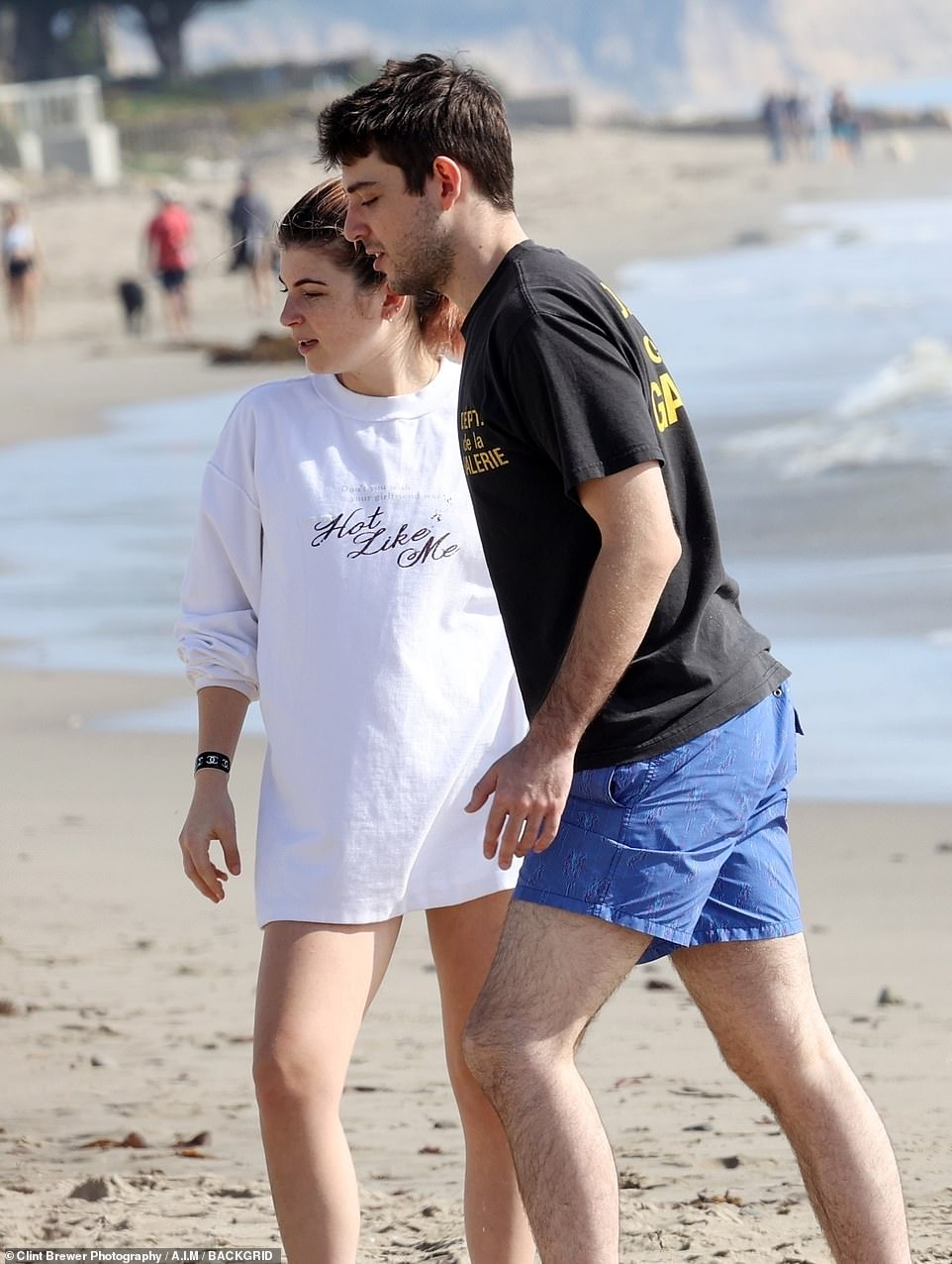 She went barefoot on the white Californian sands of the oceanfront hotel as she hung out with a male companion