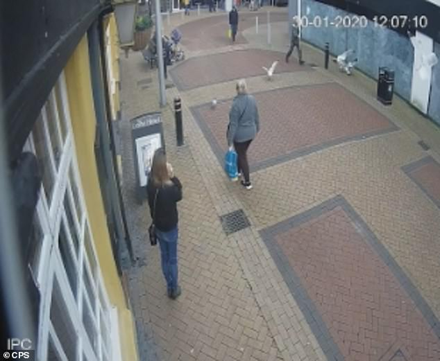 CCTV footage from Market Street captures Nicholson as he walks towards a flock of seagulls who had gathered on the pavement, clutching a white paper bag in one hand