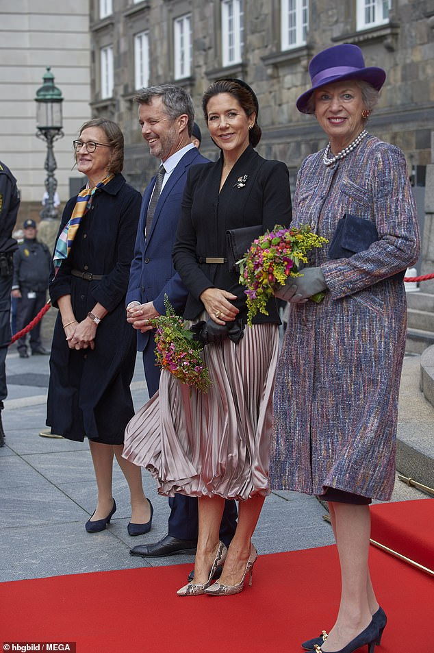 Crown Prince Frederik, 52, and Crown Princess Mary, 48, here pictured with Princess Benedikte on the opening of the Danish Parliament in October, are set to celebrate Christmas with their immediate family at Frederik VIII's Palace at Amalienborg